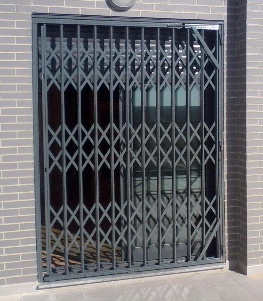 Puertas de tijera ballesta m laga batimat sl - Puerta de fuelle ...
