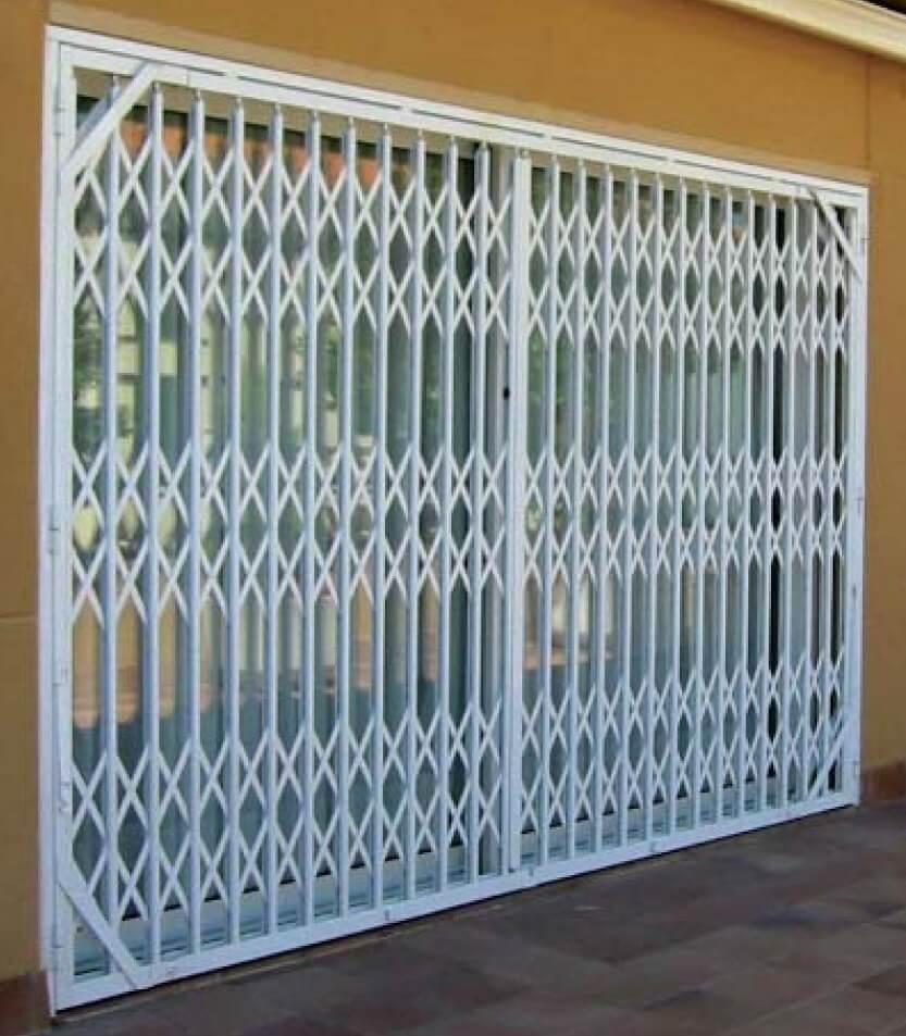 Puertas de tijera ballesta m laga batimat sl for Puertas metalicas malaga